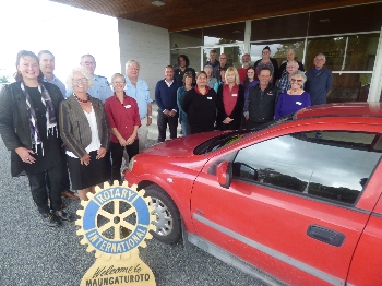 Photo: Julia Wade, Mangawhai Focus. Te Roroa staff and Rotary around car
